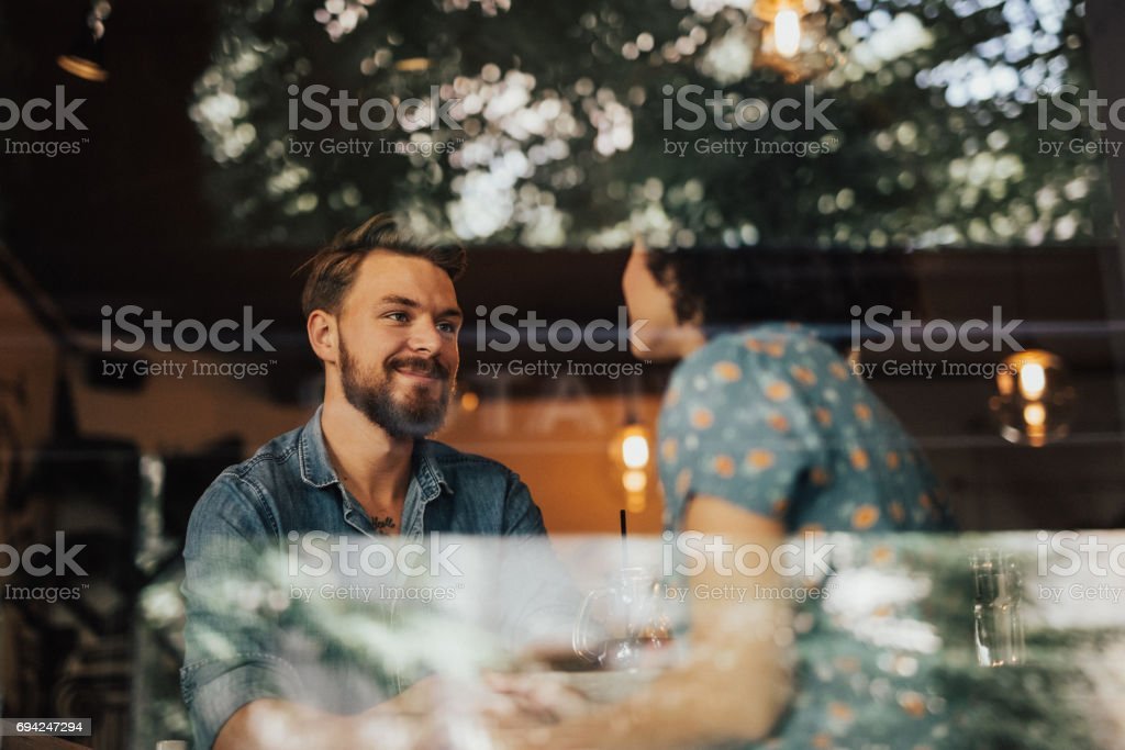 Young couple has a date at the coffee shop stock photo