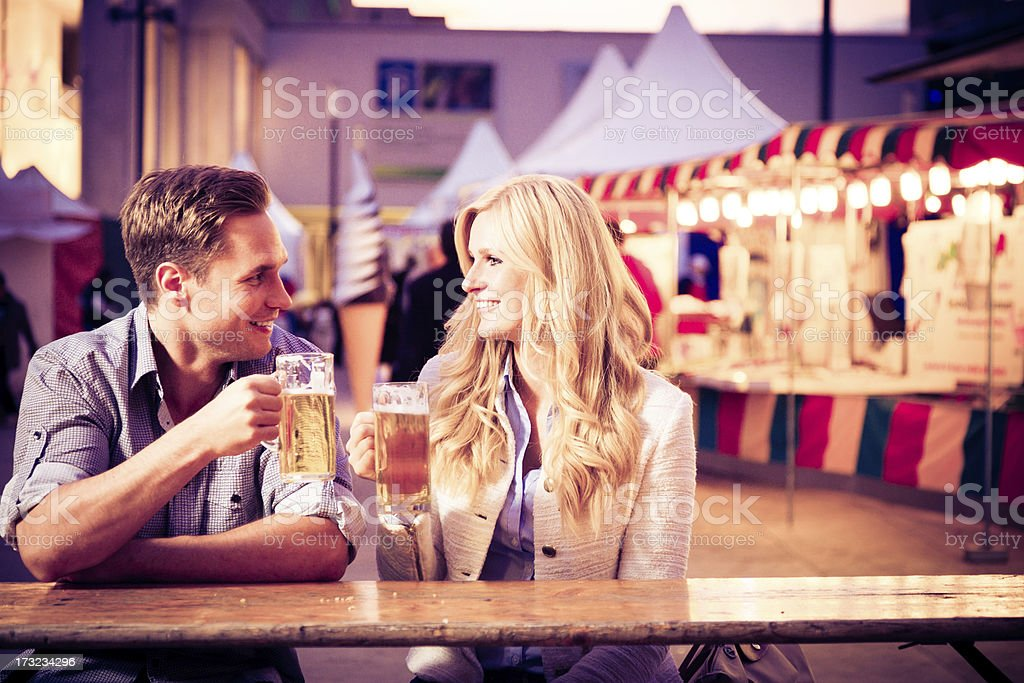 young couple having a beer royalty-free stock photo