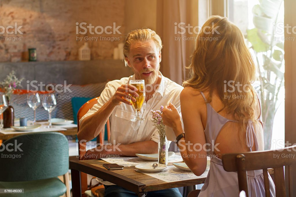 Young couple having a date in the restaurant stock photo