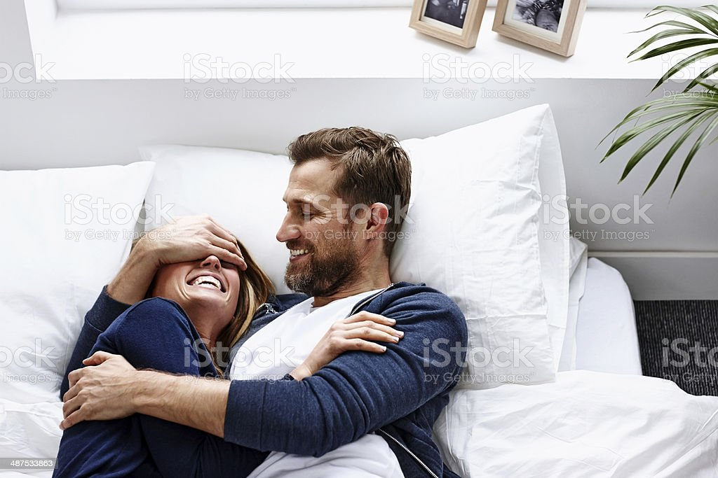 Young couple having a good time - Indoors stock photo