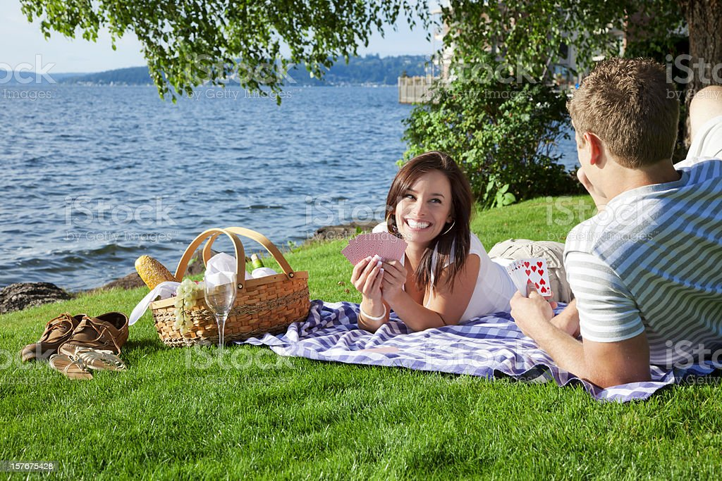Young Couple Having a Picnic at The Park royalty-free stock photo