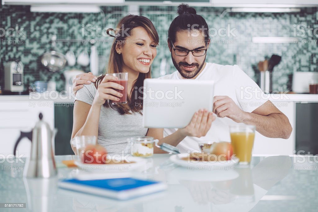 Young couple having breakfast stock photo