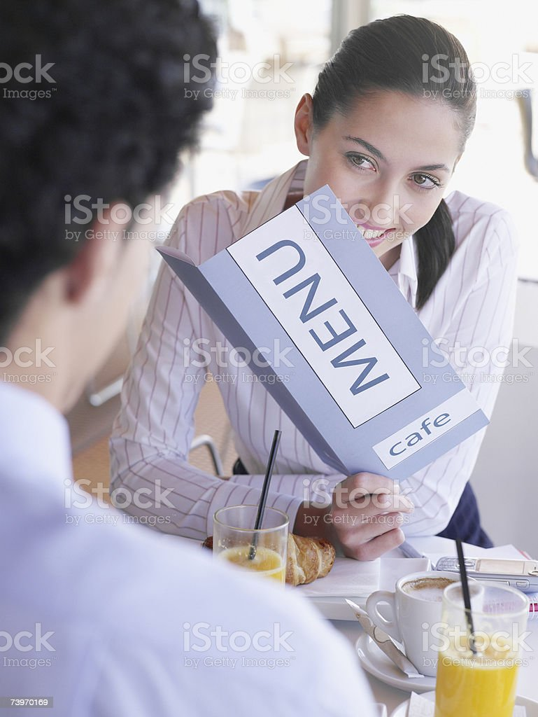 Young couple having breakfast together in a cafe royalty-free stock photo