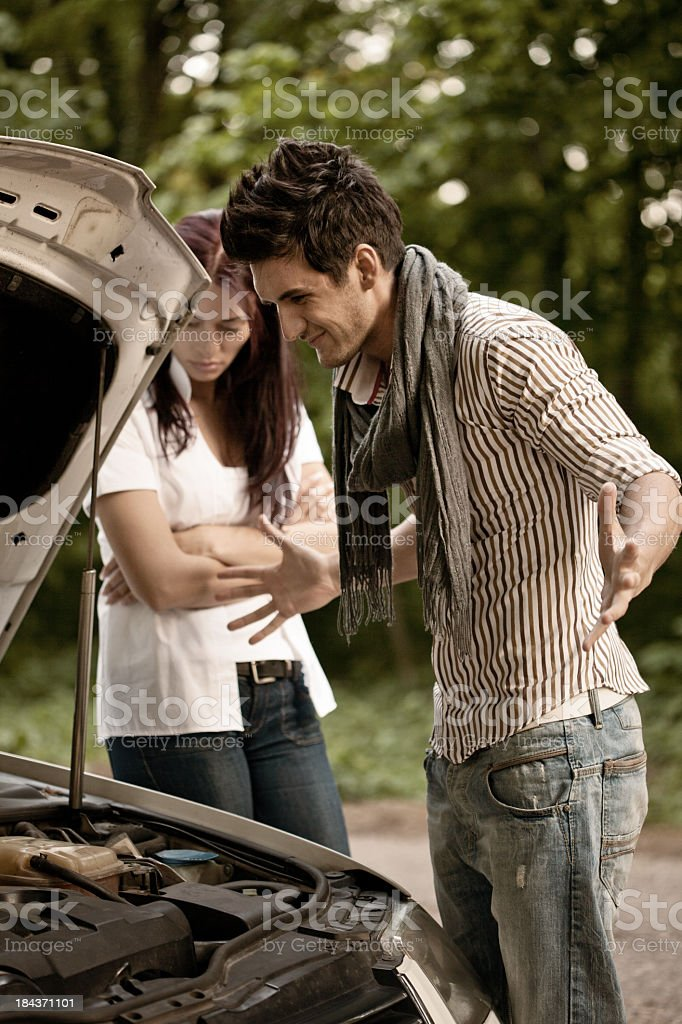Young Couple Having Car Breakdown royalty-free stock photo