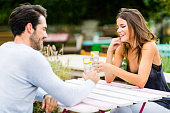 Young couple having conversation at outdoor bar