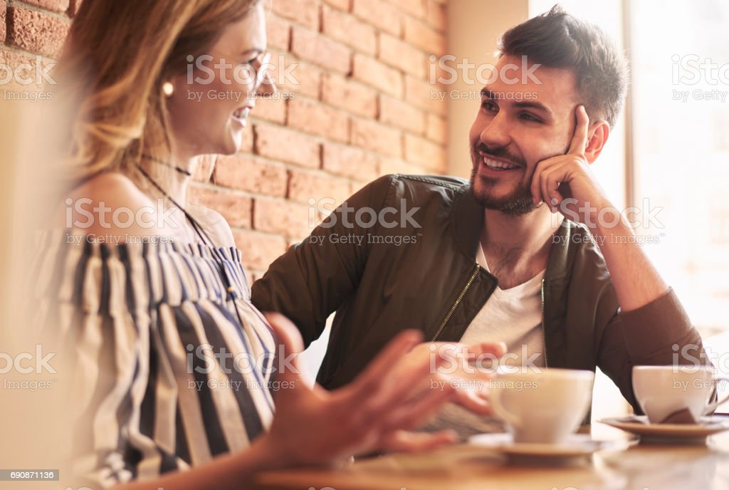 Young couple having conversation over coffee break stock photo