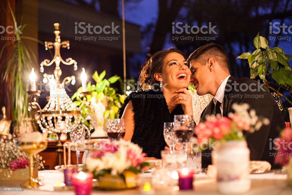 Young couple having dinner at a restaurant. stock photo
