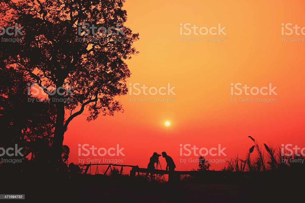 Young couple having fun at sunset time royalty-free stock photo