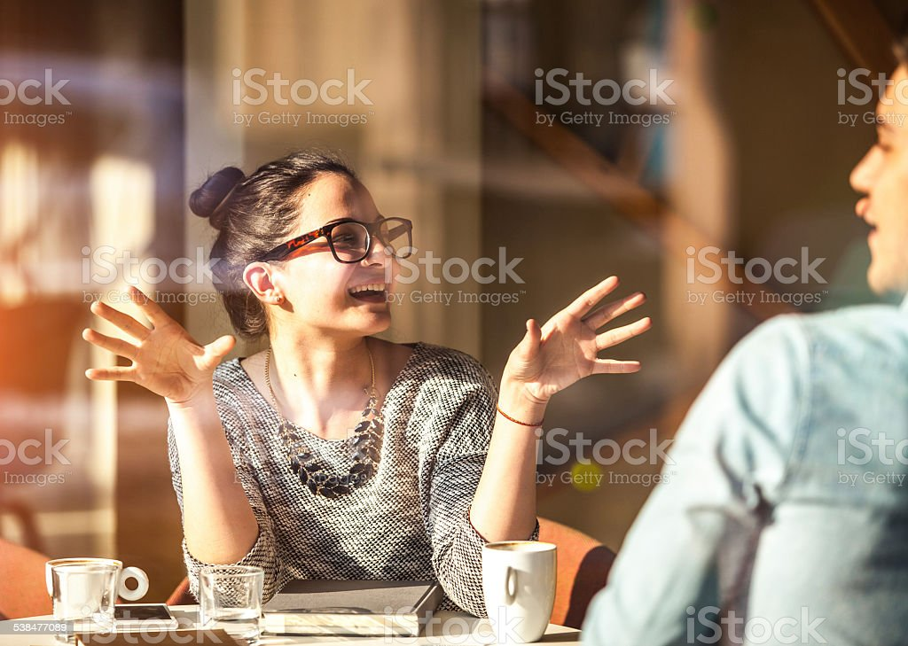 Young couple having fun at the coffee shop stock photo