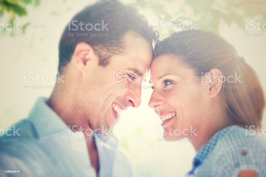 young couple having fun at the park stock photo