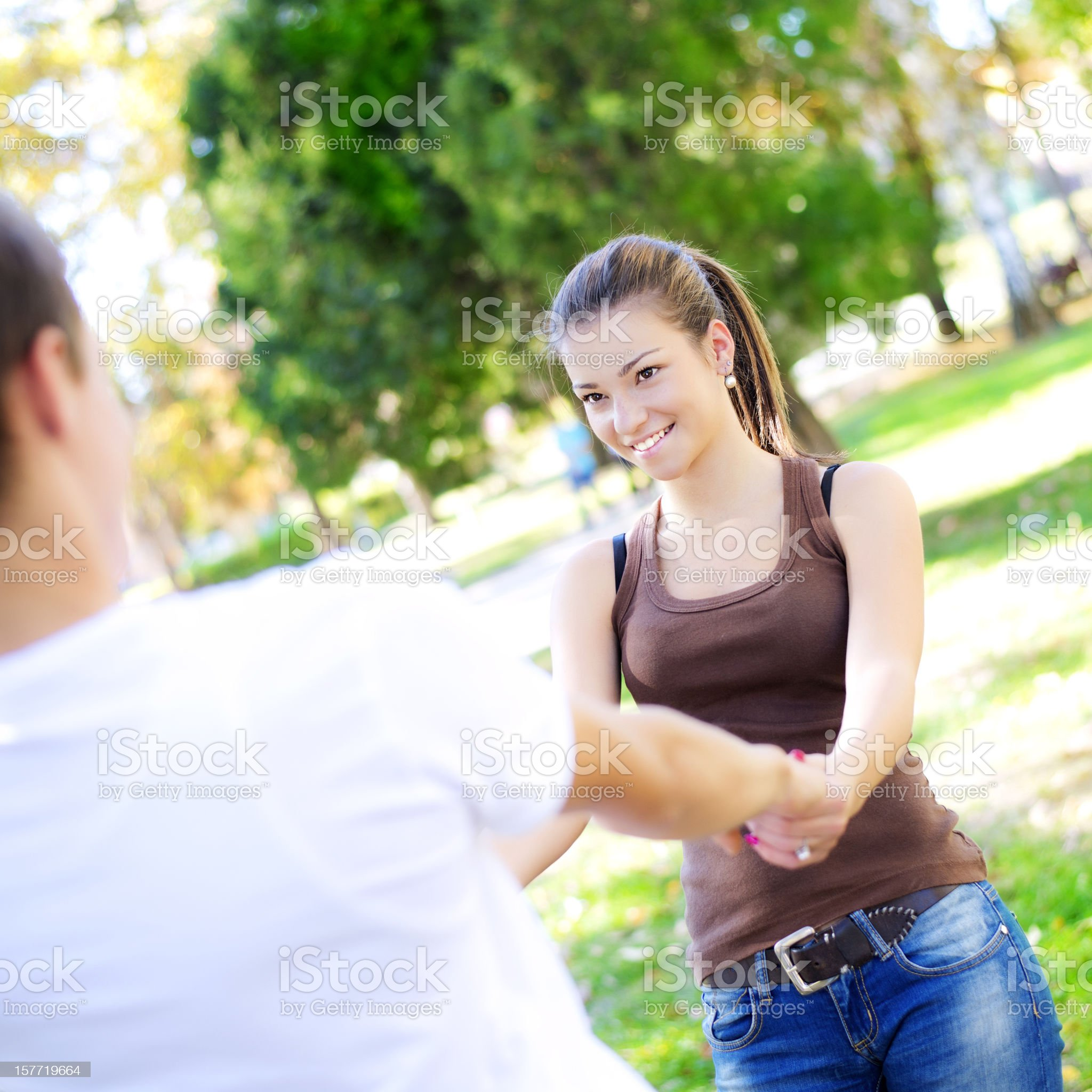 Young couple having fun at the park royalty-free stock photo
