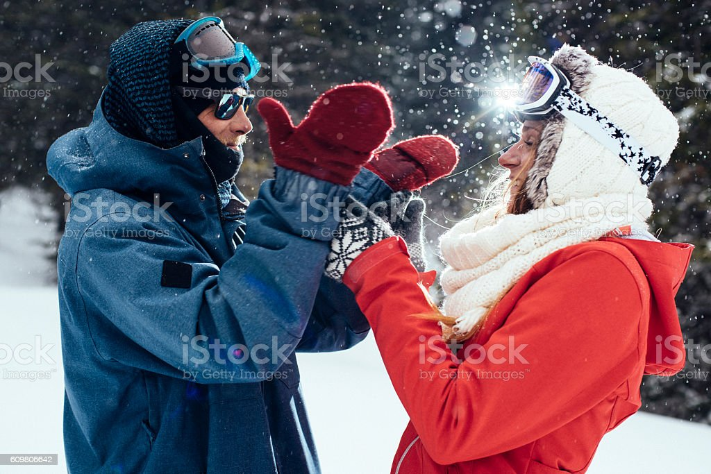 Young couple having fun in snow stock photo