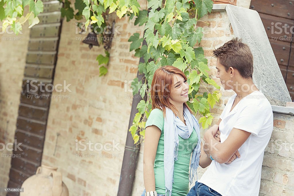 young couple having fun in the park royalty-free stock photo
