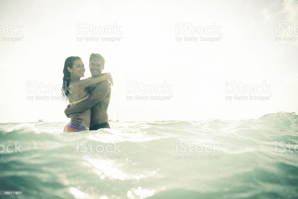 young couple having fun in the sea royalty-free stock photo