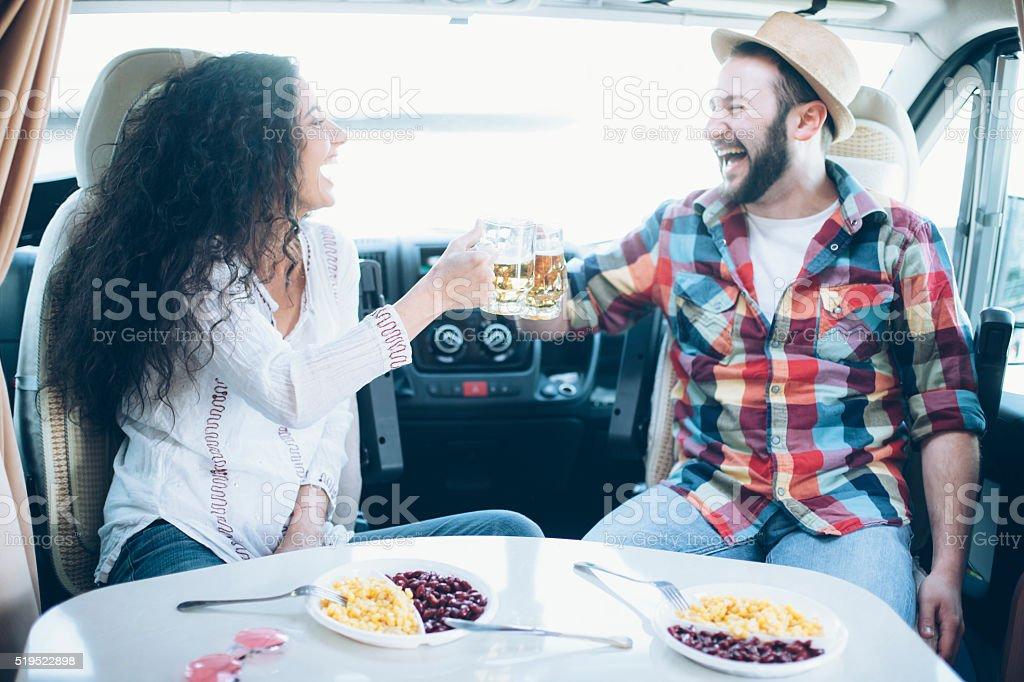 Young couple having fun inside of caravan stock photo