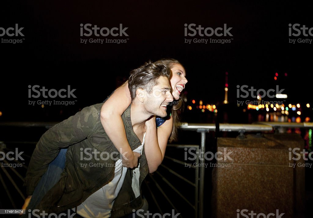 Young couple having fun on piggy back stock photo