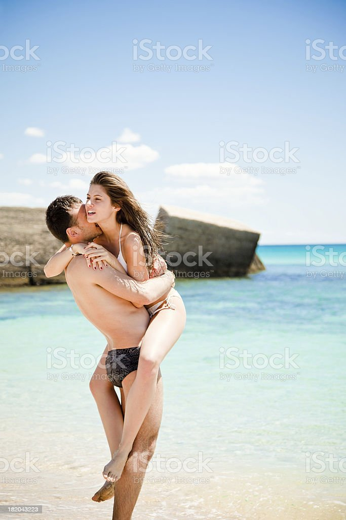 Young Couple Having Fun On The Beach stock photo