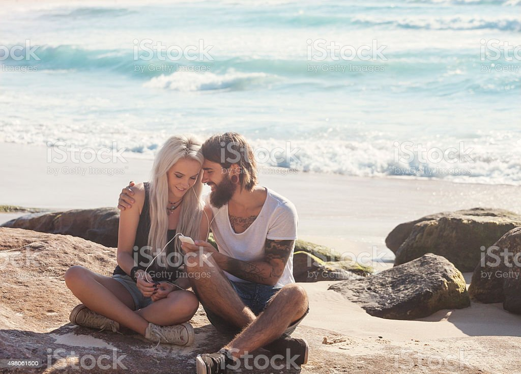 young couple having fun on the beach stock photo