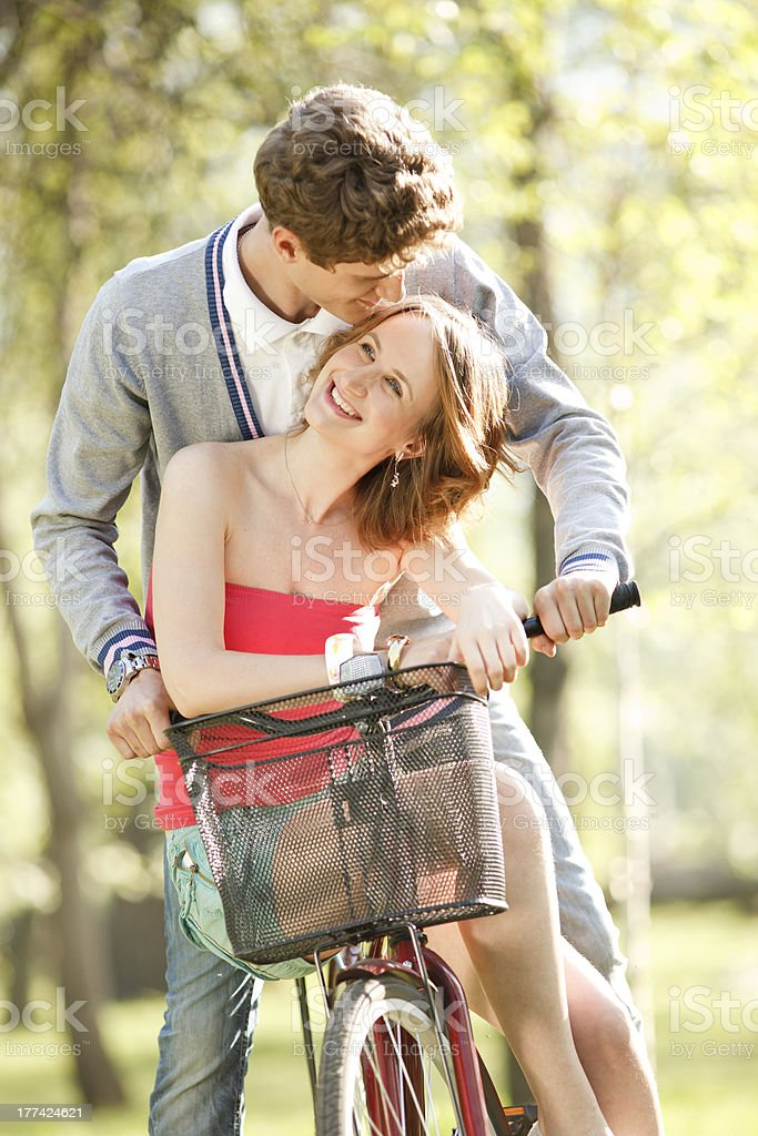 Young couple  having fun on the bicycle royalty-free stock photo