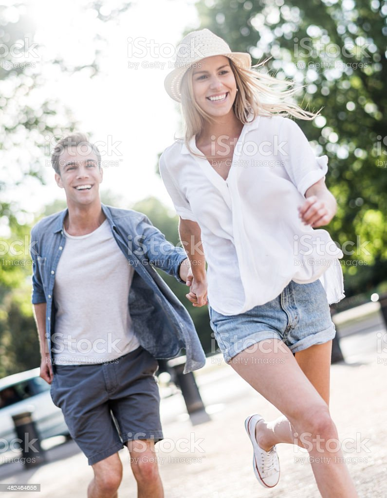 Young couple having fun outdoors stock photo