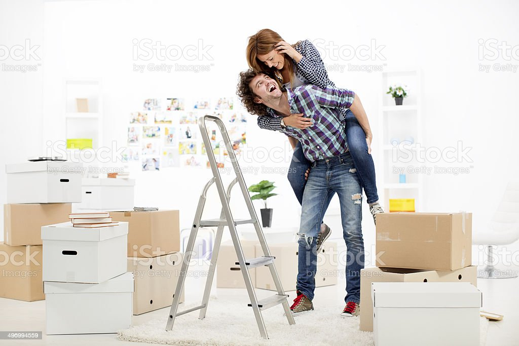 Young Couple Having Fun Renovating House. stock photo
