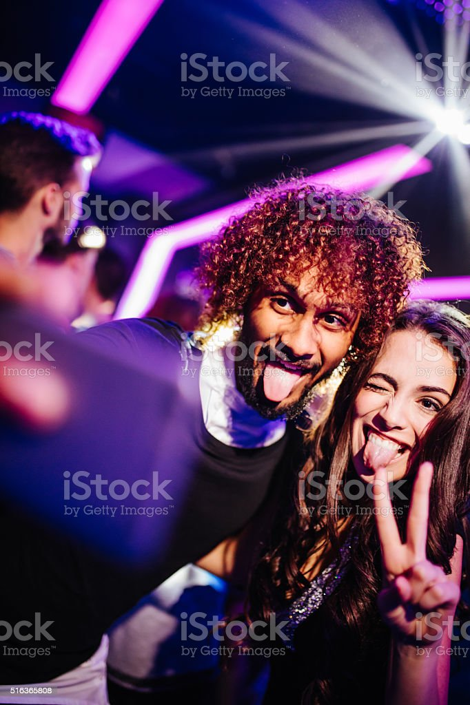 Young couple having fun with selfie at the club stock photo