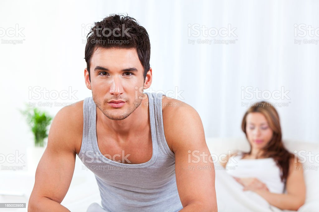 Young couple having relationship difficulties in the bedroom royalty-free stock photo