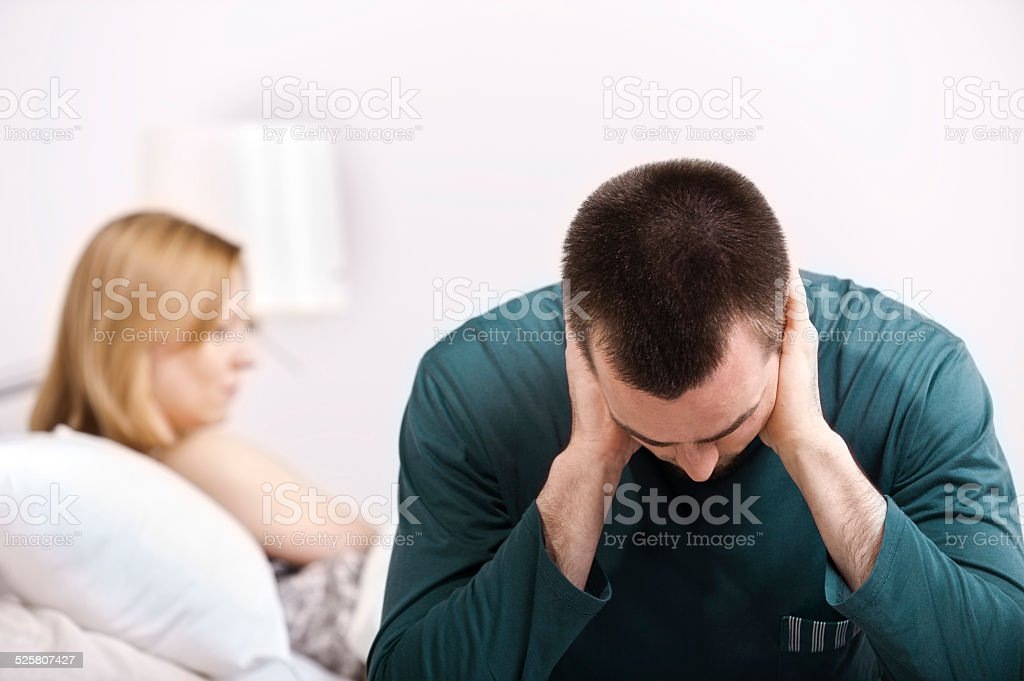 Young couple having relationship difficulties in the bedroom stock photo
