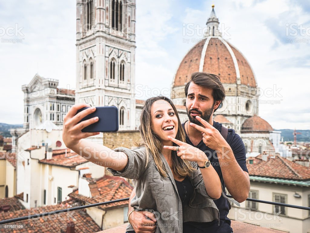 Young Couple Having Selfie In Front Of Florence's Cathedral stock photo