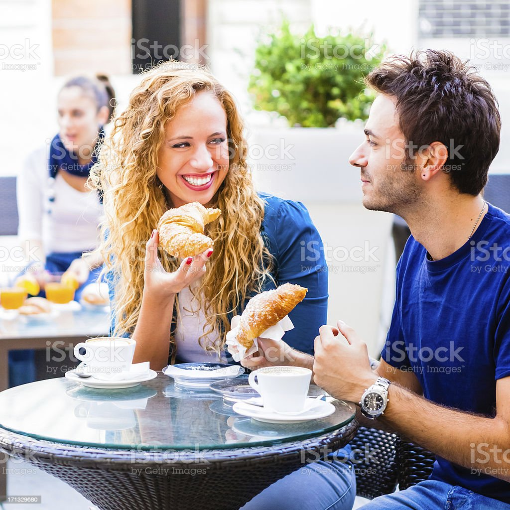 Young Couple Having Traditional Italian Breakfast at the Cafe royalty-free stock photo