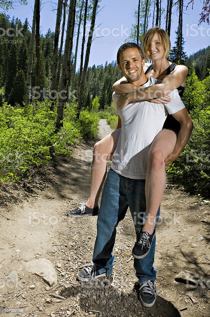 Young couple hiking in mountains royalty-free stock photo