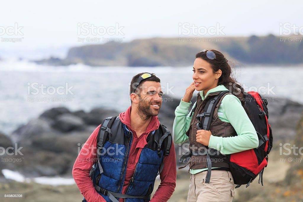 Young couple hiking in the mountain stock photo