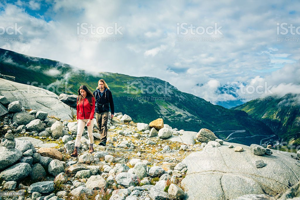 Young Couple Hiking in the Swiss Alps stock photo