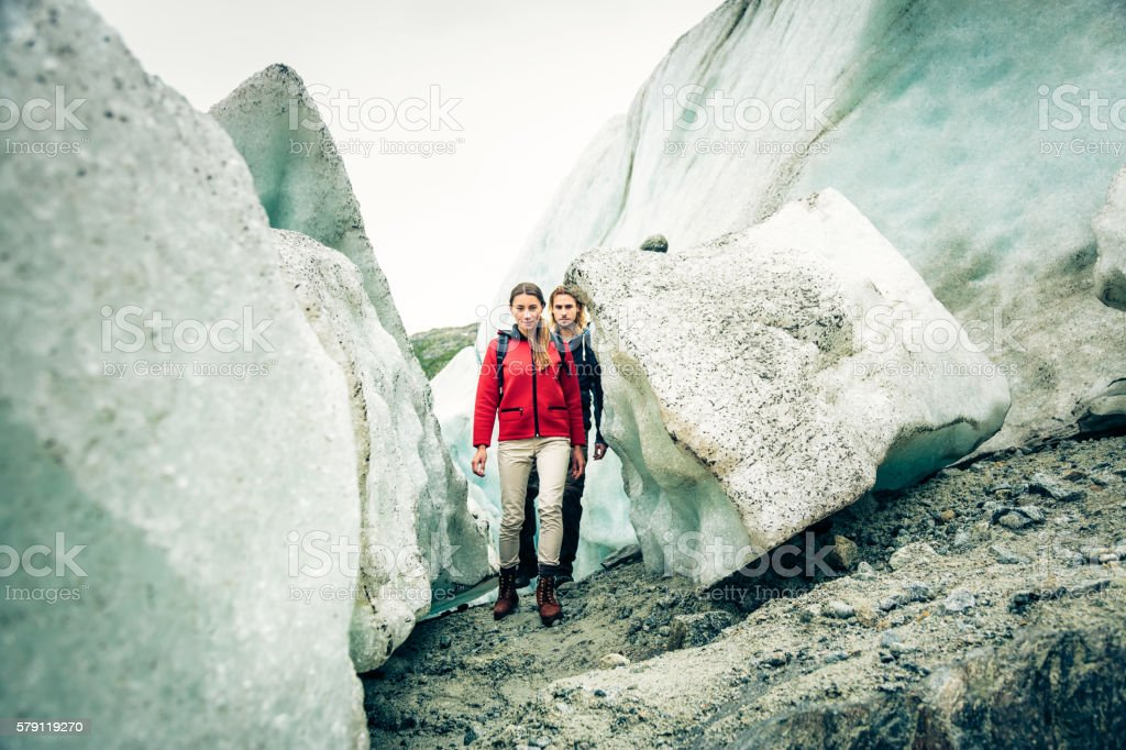 Young Couple Hiking on Glacier stock photo