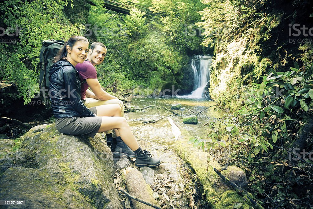 young couple hiking royalty-free stock photo
