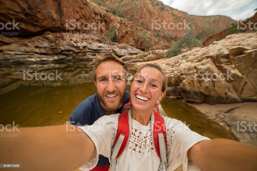 Young couple hiking take a selfie portrait stock photo