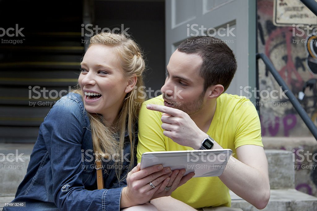 Young couple holding a Tablet royalty-free stock photo