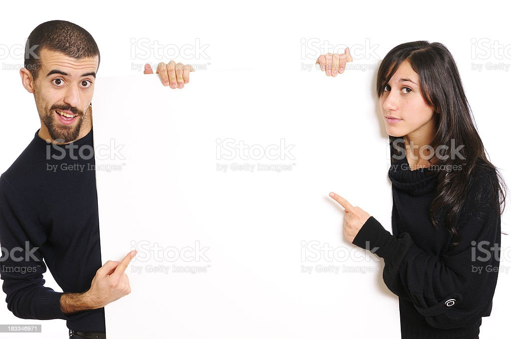 Young Couple Holding Blank Sign.Copy Space royalty-free stock photo