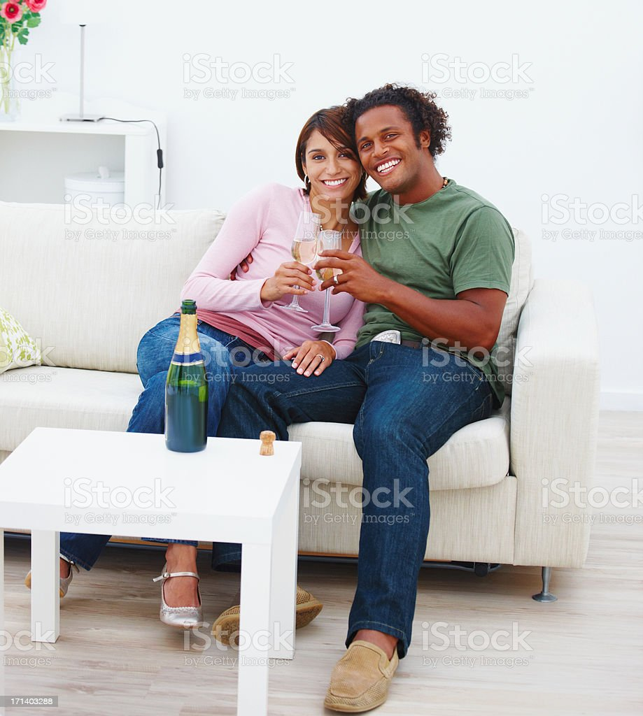 Young couple holding champagne glasses royalty-free stock photo