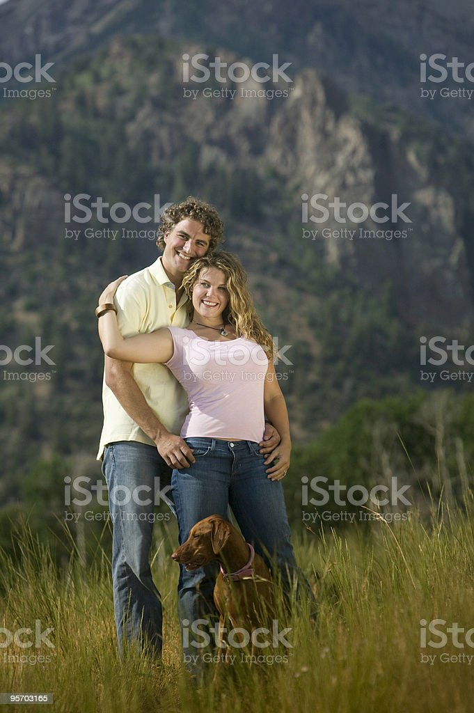 Young couple holding each other stock photo