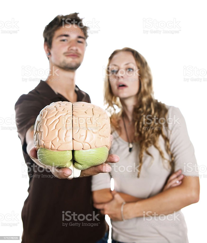 Young couple holding out model brain look interested stock photo