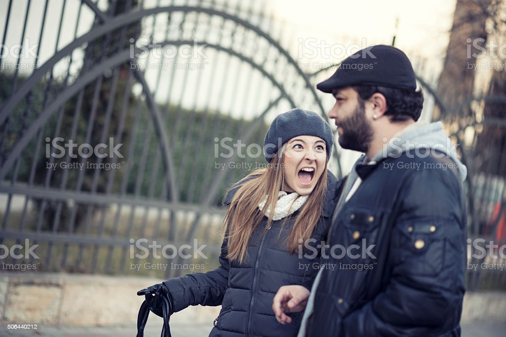 Young Couple how Arguing and Walking on the Streets stock photo