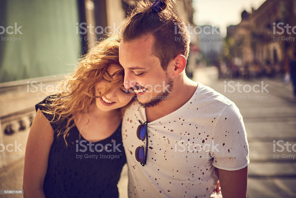 Young couple hugging in the city stock photo