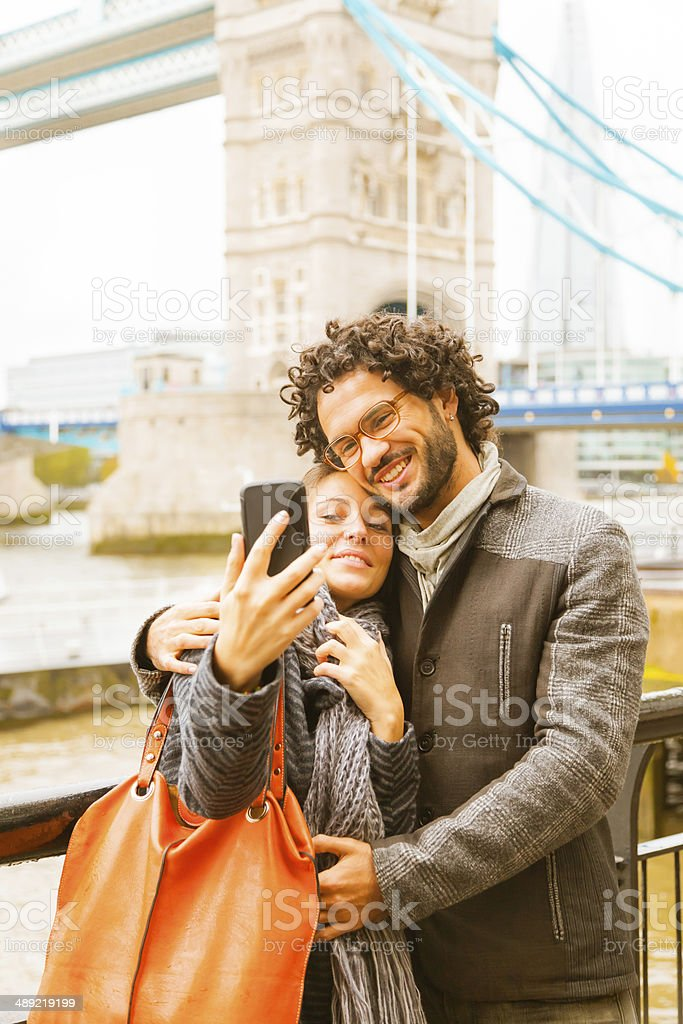 Young Couple hugging making selfies with smart phone in London stock photo