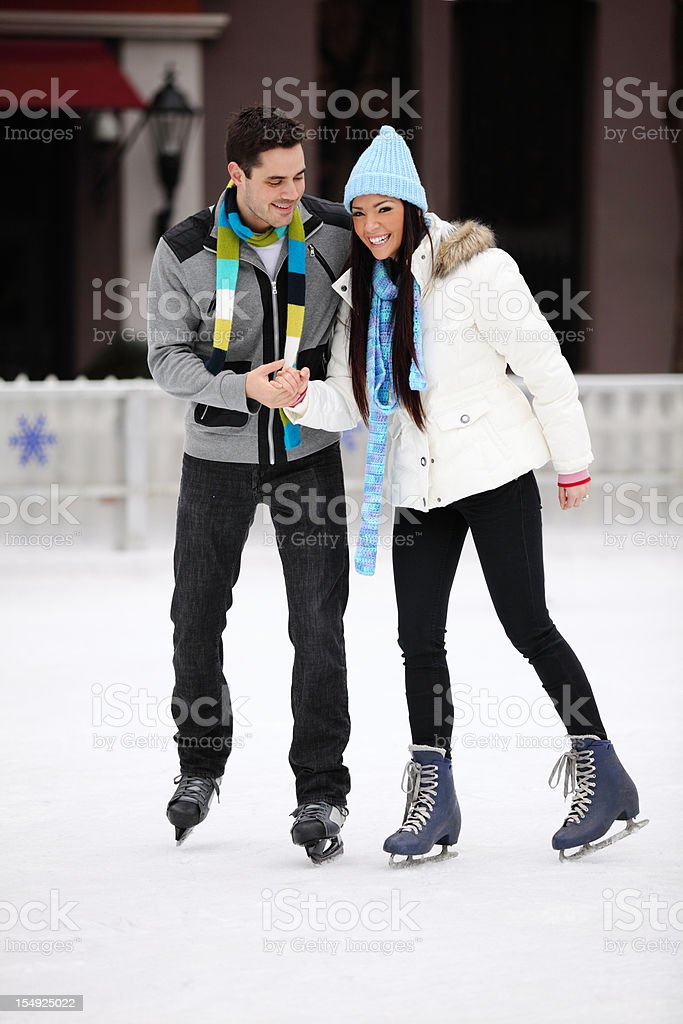 Young Couple Ice Skating royalty-free stock photo