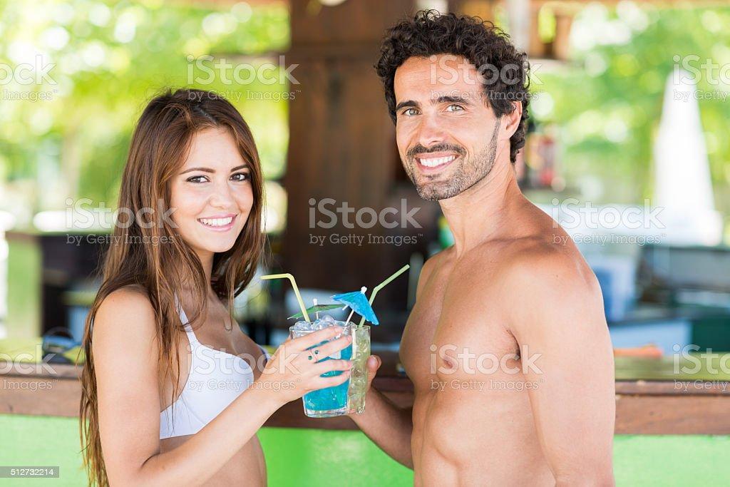 Young couple in a beach bar stock photo
