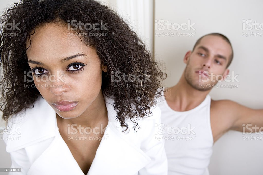 Young couple in a cautious mood with each other royalty-free stock photo