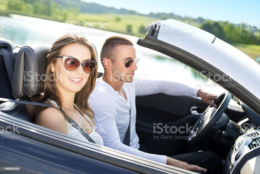 Young Couple in a Convertible car royalty-free stock photo