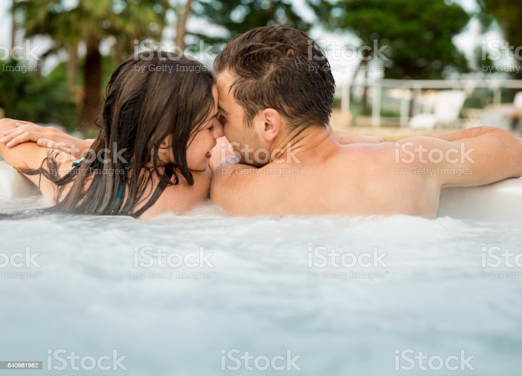 Young couple in a jacuzzi stock photo