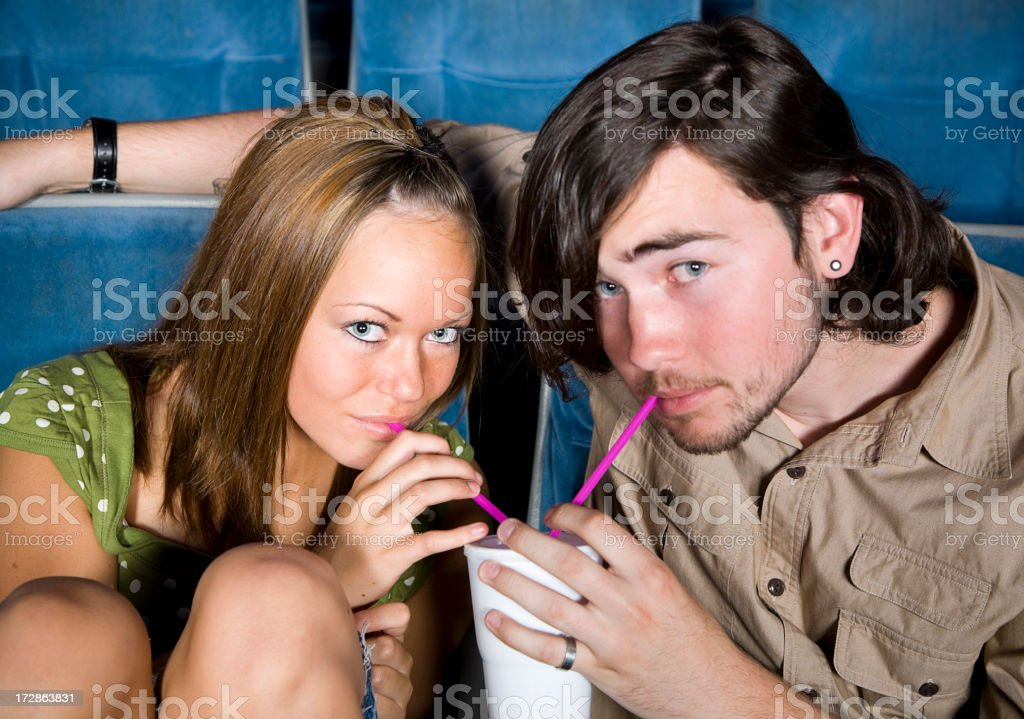 Young Couple in a Movie Theater royalty-free stock photo